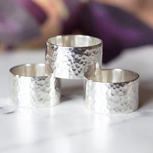 Wide hammered band rings